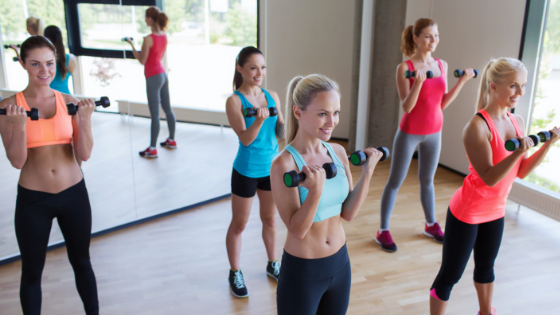 young women lifting weights in class